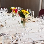 Place Settings — The glasses are set up this way so the visually impaired are still able to enjoy the wine pairings in order with the corresponding course.