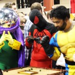 Megacon 2013 — Mysterio, Spiderman, and Wolverine Playing a Board Game